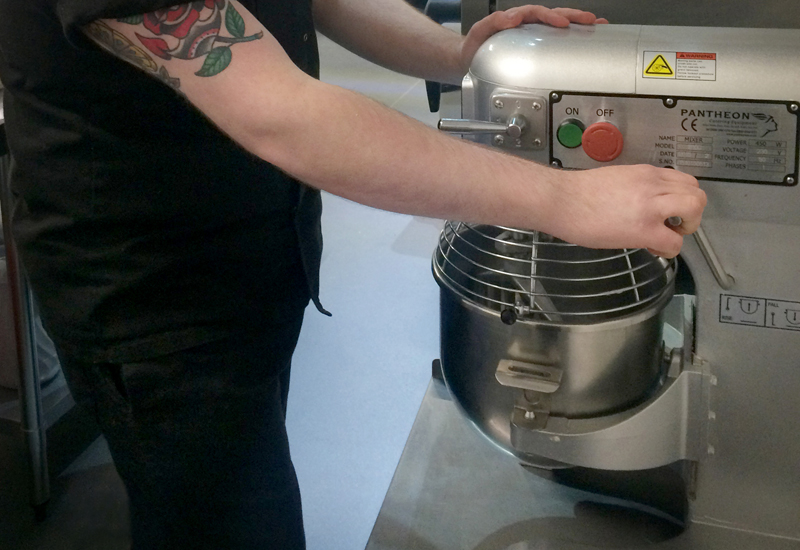 Chef Aaron Walker of Outfront Kitchens with one of his Pantheon mixers crop