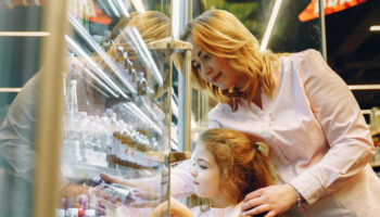 mother-buying-her-daughter-a-bottle-drink-3985075 crop