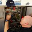 Meiko engineer inside controls of large dishwasher 2250 crop