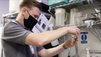 A Winterhalter engineer conducting a water quality test crop